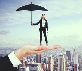 Pretty businesswoman with umbrella
