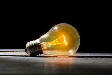 Old bulb stays lighting on, isolated on Idea concept.