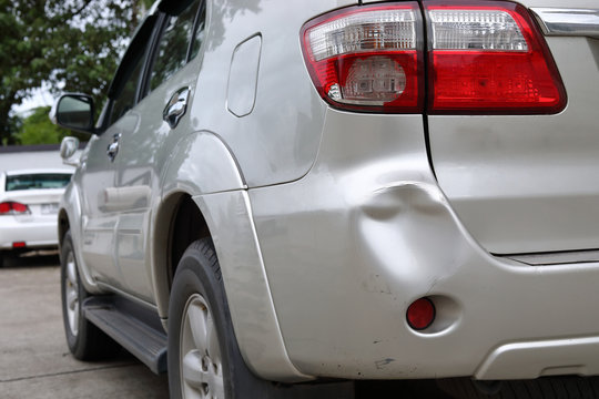 vehicle car bumper dent and taillight broken collision crash damage accident on road