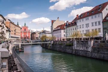 Ljubljana in Slovenia on a cloudy day - River, bund, Ljubljana Castle