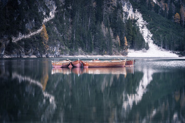 Wooden boats at the alpine mountain lake