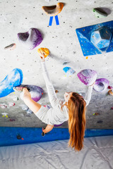 Awesome woman climbing indoor look up