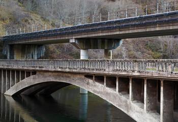 Reservoir with concrete bridge across