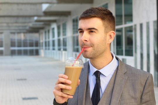 Businessman drinking an ice coffee