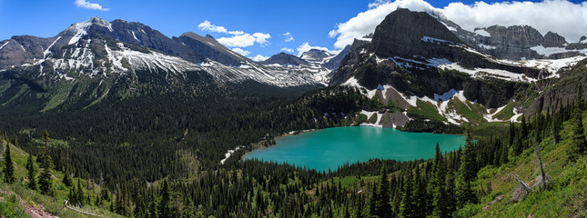 Summertime panorama of Grinnell lake in Glacier NP, Montana