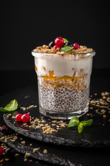 Сhia pudding or yogurt with granola, mango or peach. Healthy breakfast concept and idea. Detox and healthy superfoods.