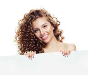 Smiling young woman with blank paper board background with copy space for advertising marketing or product placement
