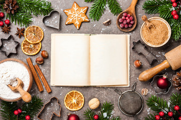 Christmas background. Table for holiday baking cookies with ingredients and recipe book