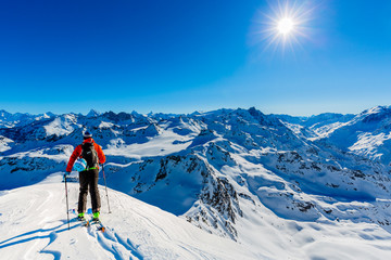 Wall Mural - Ski with amazing view of swiss famous mountains in beautiful winter snow Mt Fort. The skituring, backcountry skiing in fresh powder snow.