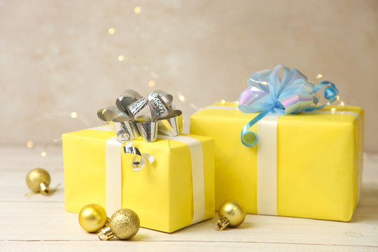 Two yellow Christmas gifts