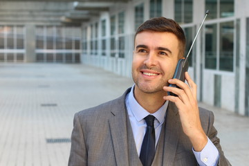 Businessman calling with old style wireless landline telephone