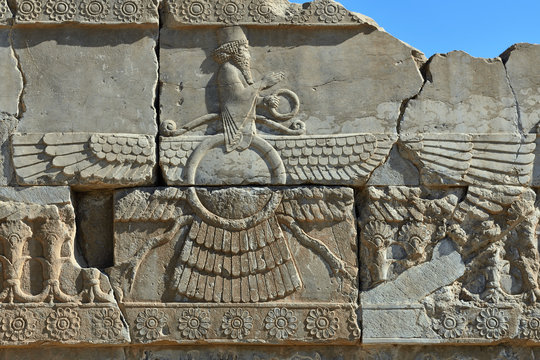 The beautiful reliefs - symbols of Zoroastrian in the ruins of Ancient Persepolis Complex of Near Eastern civilisation with persian architecture, Pars - Iran