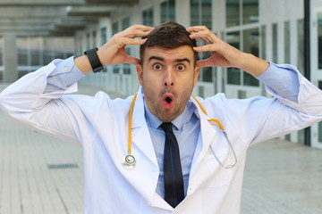 Shocked looking doctor close up