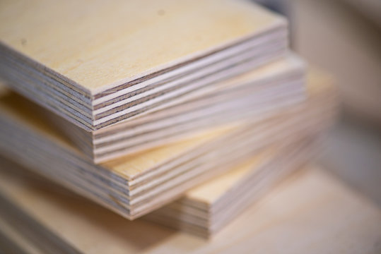 Close-up of plywood sheets at carpentry on wooden table