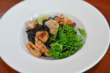 Black spaghetti with squid and shrimp paste sauce