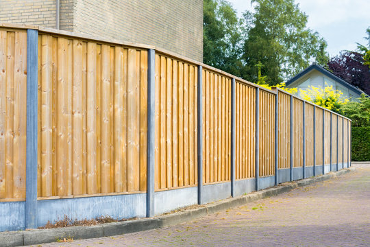 New wooden fence along the street