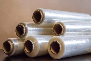 Packing material. Many rolls of stretch film are white transparent. Polymer product for wrapping.
