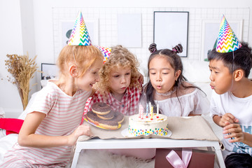 friendship concept. everybody is blowing out the candles in the room , closeup photo. common wish. one dream