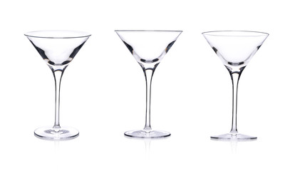 Three empty martini glasses isolated on white background