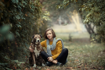 Friendship between a girl and a dog