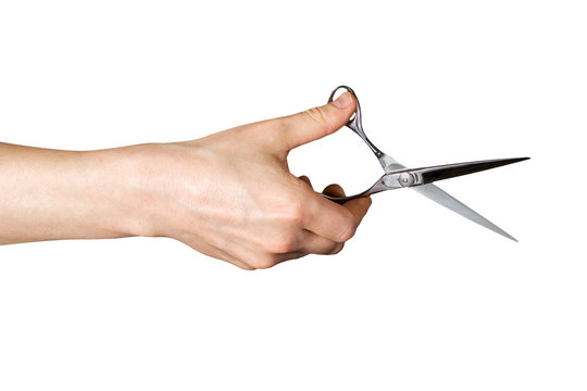 hand holding a scissors on an isolated white background