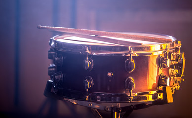 snare drum with sticks on a beautiful colored background