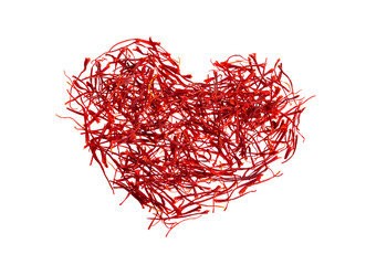 Saffron's silhouette of the heart. Delicate saffron threads, plucked from crocus flowers and dried. Isolated on white background