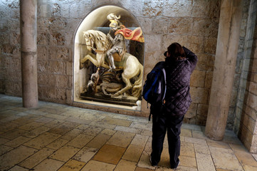 A tourist takes a picture at the Church of the Nativity in Bethlehem