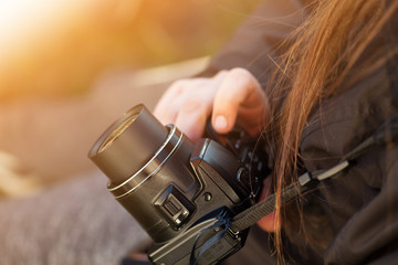 Girl holding camera in her hand