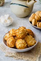 Different types of cookies on delicate background