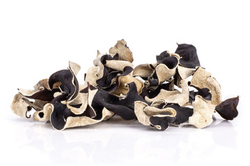 Lot of slices of dry black mushroom jew ear variety stack isolated on white background
