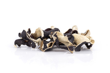 Lot of slices of dry black mushroom jew ear variety isolated on white background