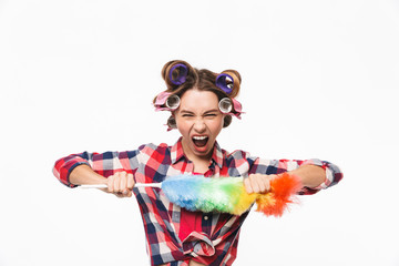 Angry housewife with curlers in hair standing