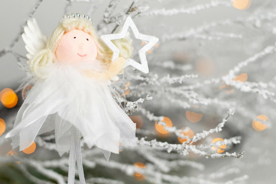 Cute Christmas angel holding star