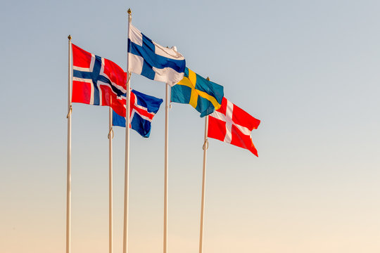 Danish, Swedish, Icelandic, Finnish and Norwegian scandinavian flags waving on the wind in Helsinborg, Sweden