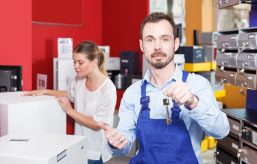 Confident man proffering keys to young client
