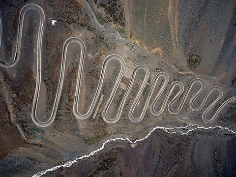 Serpentine roadway in desert from drone