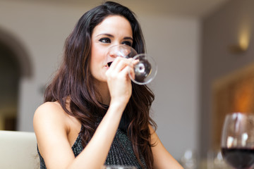 Beautiful woman holding a glass of red wine