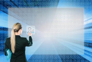 Businesswoman touching virtual interface