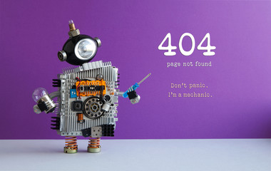 404 error page not found concept. Don't panic I'm a mechanic. Toy robot with screwdriver and light bulb. Purple wall gray floor background.
