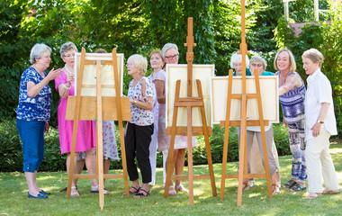 Group of senior ladies enjoying an art class.