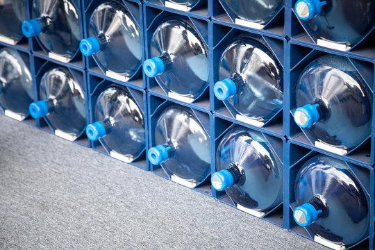 Rack of water cooler jugs