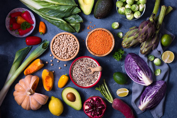 Healthy vegan food, cooking ingredients with fresh vegetables, quinoa, lentils, chickpeas, clean eating concept