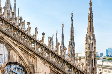 Marble statues - architecture on roof of Duomo gothic cathedral in Milan