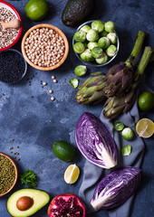 Healthy vegan cooking ingredients, fresh vegetables, chickpeas, quinoa, lentils, clean eating concept, top view, flat lay