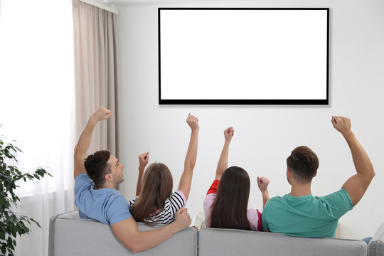 Friends watching TV on sofa at home. Mockup for design