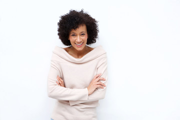 older woman smiling with arms crossed against white background