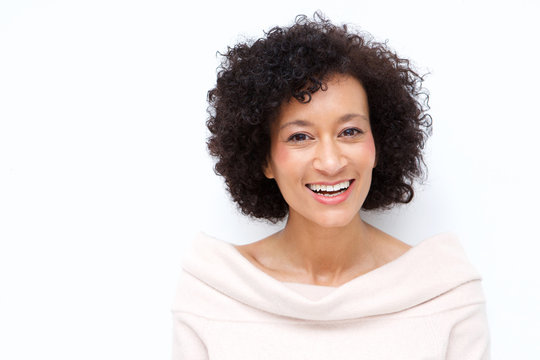Close up attractive middle age african american woman smiling against white background