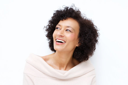 Close up attractive middle age african american woman laughing against white background