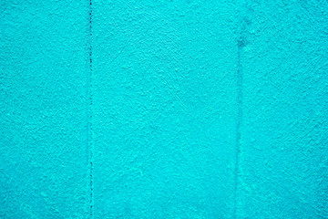 The texture of plastered tiffany blue wall with joints, background